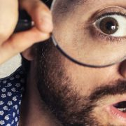 Man looking magnifying glass