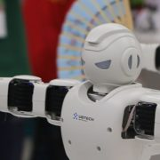 Robots with Chinese fans at Griffith University
