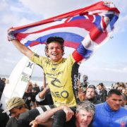 John John Florence (HAW) is chaired up the beach as the World Surf League Champion and winner of the MEO Rip Curl Pro Portugal. Image: WSL /  Cestari