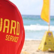 A surf lifesaver at the beach for the Australian Lifeguard Service