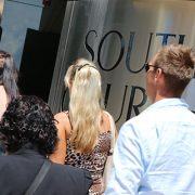 A-crowd-of-people-walking-into-Southport-Courthouse