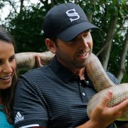 Angela and Sergio Garcia with a black headed python